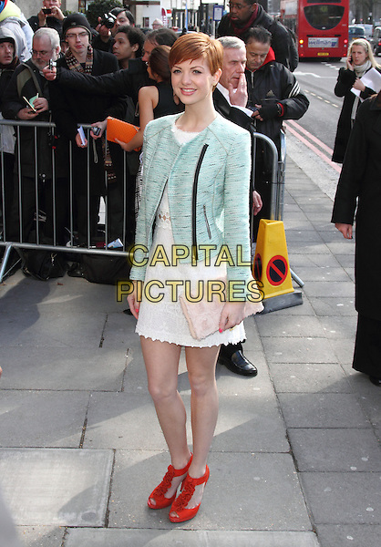 Lucy Dixon.The TRIC Awards 2013 (Television and Radio Industries Club Awards) at the Grosvenor House Hotel, Park Lane, London, England..March 12th, 2013.full length white dress lace red shoes pink clutch bag green jacket blazer .CAP/ROS.©Steve Ross/Capital Pictures