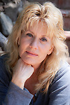 Portrai of a beautiful blond woman in her 50s