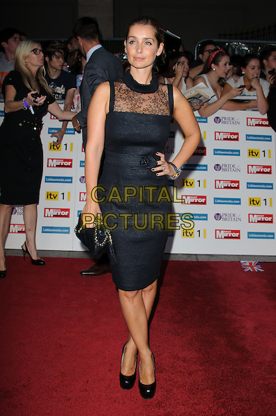 Louise Redknapp.'The Daily Mirror's Pride Of Britain Awards 2011' at Grosvenor House Hotel, London, England..3rd October 2011.full length black dress hand on hip sleeveless lace clutch bag.CAP/CJ.©Chris Joseph/Capital Pictures.