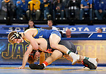 BROOKINGS, SD - NOVEMBER 17: Spencer Huber from South Dakota State University battles with Daton Fix from Oklahoma State University during their 133 pound match Saturday night at Frost Arena in Brookings. (Photo by Dave Eggen/Inertia)