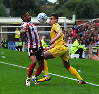 Lincoln City's Nathan Arnold vies for possession with Morecambe's Aaron McGowan<br /> <br /> Photographer Andrew Vaughan/CameraSport<br /> <br /> The EFL Sky Bet League Two - Lincoln City v Morecambe - Saturday August 12th 2017 - Sincil Bank - Lincoln<br /> <br /> World Copyright &copy; 2017 CameraSport. All rights reserved. 43 Linden Ave. Countesthorpe. Leicester. England. LE8 5PG - Tel: +44 (0) 116 277 4147 - admin@camerasport.com - www.camerasport.com