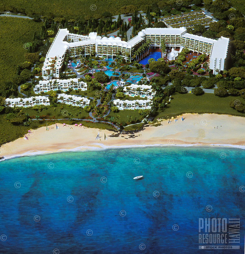 The beautiful Kea Lani (Hawaiian: white heaven) Hotel at Wailea, Maui, surrounded by lush green trees, a white sand beach and the deep blue Pacific ocean.
