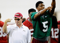 TALLAHASSEE, FLA.8/6/13-FSU080613CH-Florida State Head Coach Jimbo Fisher, center, motions during the Seminole's first day of practice Aug. 6, 2013 in Tallahassee, Fla.<br /> <br /> COLIN HACKLEY PHOTO