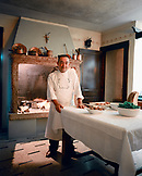 ITALY, Soave, portrait of Chef Giorgo Soave standing in the dining room of his Ristorante Groto De Corgnan.