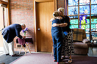 "Nancy Shilts (right), of Scituate, embraces Nancy Richards-Stower at St. Frances Xavier Cabrini Church in Scituate, Mass., on Sun., May 29, 2016. Shilts has been a member of the church since it opened in 1961. Richards-Stower, and husband Rev. Richard Stower (left), came to the last service to express support of the congregation. Rev. Stower said, ""[The vigil] is a reminder of what the early Christian church was about."" Members of the congregation have been holding a vigil for more than 11 years after the Archdiocese of Boston ordered the parish closed in 2004. For 4234 days, at least one member of Friends of St. Frances X. Cabrini has been at the church at all times, preventing the closure of the church. May 29, 2016, was the last service held at the church after members finally agreed to leave the building after the US Supreme Court decided not to hear their appeal to earlier an Massachusetts court ruling stating that they must leave. The last service was called a ""transitional mass"" and was the first sanctioned mass performed at the church since the vigil began."