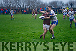 Dromids Shane O'Connor tries to break free from St Mary's Aidan Walsh challenge but win the free for an over zealous challenge.