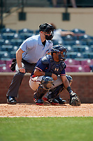 Rome Braves catcher Carlos Martinez (19) waits to receive a pitch in front of home plate umpire John Budka during a game against the Lexington Legends on May 23, 2018 at Whitaker Bank Ballpark in Lexington, Kentucky.  Rome defeated Lexington 4-1.  (Mike Janes/Four Seam Images)