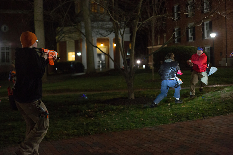 Justin Mooney, an Athens resident, aims at a zombie during a Humans vs. Zombies mission on College Green on March 22, 2017.