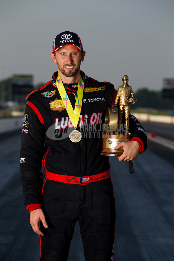 Sep 7, 2015; Clermont, IN, USA; NHRA top fuel driver Morgan Lucas poses for a portrait as he celebrates after winning the US Nationals at Lucas Oil Raceway. Mandatory Credit: Mark J. Rebilas-USA TODAY Sports