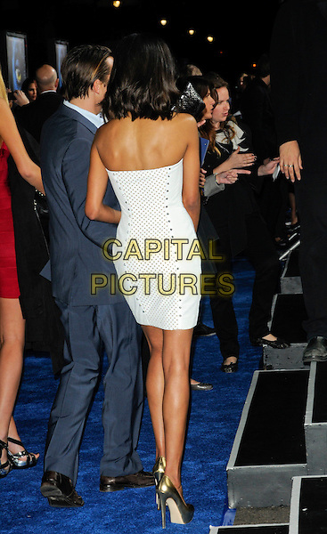 "ZOE SALDANA.The Los Angeles premiere of ""Avatar"" at Grauman's Chinese Theatre in Hollywood, California, USA..December 16th, 2009.full length silver gold strapless dress shiny white sides platform shoes metallic studs studded back behind rear .CAP/ROT.©Lee Roth/Capital Pictures"