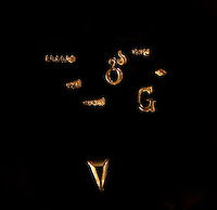 Dans son atelier parisien, le 20 janvier 2011, le sculpteur orfèvre Goudji travaille des pièces de futures créations. Détail de monogrammes réalisés par l'artiste et portant le poinçon de Goudji. In his Parisian studio, on January 20, 2011, goldsmith Goudji is working new creations of his trade. Detail of monograms created by Goudji and wearing his stamp. Born in Georgia in 1941, Goudji has lived in Paris since 1974, due to the personal intervention of President Georges Pompidou. Here he produces his numerous contemporary works of goldsmithery in such widely differing fields as Church Art, swords, jewellery and sculpture. Picture by Manuel Cohen