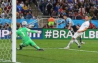 Luis Suarez of Uruguay scores a goal to make the score 2-1
