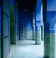 A Moroccan courtyard is characterised by its traditional arches and ceramic tiled floor while hand-painted tiles decorate the columns