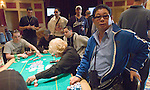 A big pot between Joe Peilton & Can Hua.  Pelton won and Hua reacts.