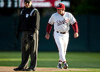 STANFORD, CA - April 12, 2011: Head coach Mark Marquess of Stanford baseball argues a call at first during Stanford's game against Pacific at Sunken Diamond. Stanford won 3-1.