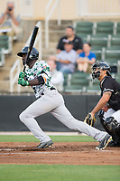 Jacob Heyward (10) of the Augusta GreenJackets follows through on his swing against the Kannapolis Intimidators at Kannapolis Intimidators Stadium on May 3, 2017 in Kannapolis, North Carolina.  The Intimidators defeated the GreenJackets 7-4.  (Brian Westerholt/Four Seam Images)