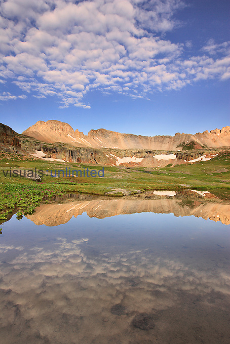 Reflection of Three Needles Mountain and Porphyry Basin, San Juan Mountains of Colorado, USA.