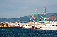 Piraeus, Greece. Boats in the Marina. Athens in the background.