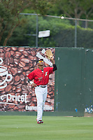 Kannapolis Intimidators left fielder James Baldwin (37) settles under a fly ball during the game against the Lakewood BlueClaws at CMC-Northeast Stadium on May 17, 2015 in Kannapolis, North Carolina.  The Intimidators defeated the BlueClaws 4-1.  (Brian Westerholt/Four Seam Images)