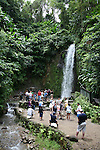Tourists visiting Toraille Waterfall in St. Lucia