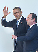 United States President Barack Obama waves as he and President Francois Hollande of France walk on the Colonnade to the Oval Office following a State Arrival ceremony on the South Lawn of the White House in Washington, D.C. on Tuesday, February 11, 2014.<br /> Credit: Ron Sachs / CNP