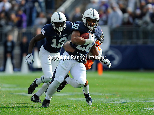 31 October 2015:  Penn State RB Saquon Barkley (26) runs through a tackle by Illinois CB Eaton Spence (27).The Penn State Nittany Lions defeated the Illinois Fighting Illini 39-0 at Beaver Stadium in State College, PA. (Photo by Randy Litzinger/Icon Sportswire)