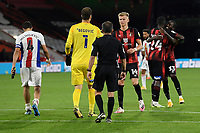 AFC Bournemouth players celebrate after winning the penalty shoot out as Luka Milivojević of Crystal Palace left who had his penalty saved walks off during AFC Bournemouth vs Crystal Palace, Carabao Cup Football at the Vitality Stadium on 15th September 2020