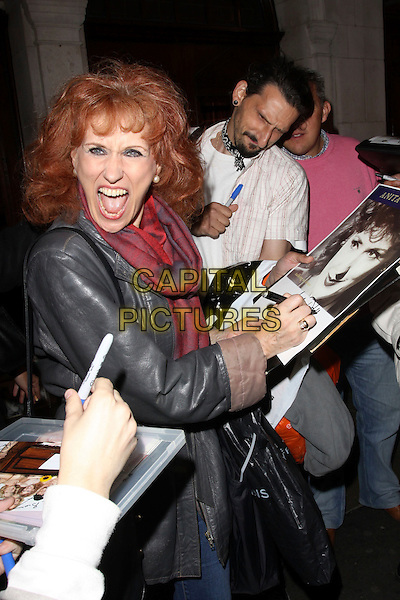 "ANITA DOBSON.""Calendar Girls"" West End production cast change night, Noel Coward Theatre, London, England..July 28th 2009.half length grey gray leather jacket red mouth open funny face signing autographs fans scarf .CAP/AH.©Adam Houghton/Capital Pictures."