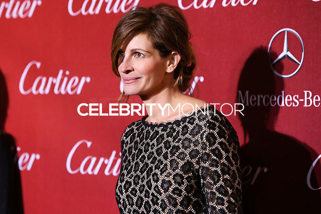 PALM SPRINGS, CA - JANUARY 04: Actress Julia Roberts wearing a Gucci one of a kind beige and black leopard pattern lace mini dress with gold sequence detail and black patent leather closed toe heels arriving at the 25th Annual Palm Springs International Film Festival Awards Gala held at Palm Springs Convention Center on January 4, 2014 in Palm Springs, California. (Photo by Xavier Collin/Celebrity Monitor)