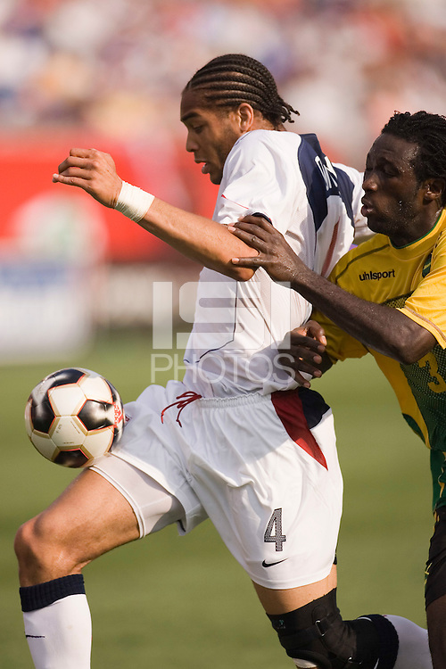 Jamaica's Damion Stewart closely marks USA's Oguchi Onyewu. The United States defeated Jamaica 3 to 1 in quarterfinal CONCACAF Gold Cup action at Gillette Stadium, Foxbourgh, MA, on July 16, 2005.