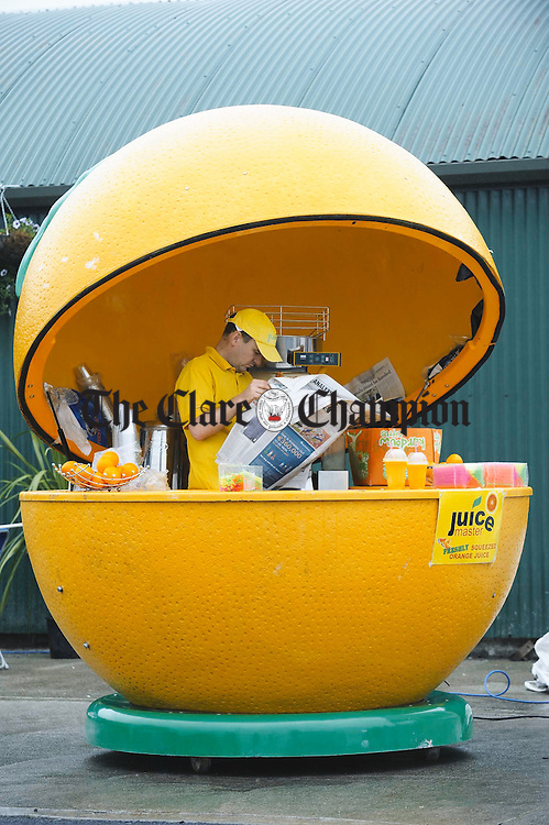 The juice man reads his Sunday paper during a quiet at the Clare County Show in Ennis. Photograph by John Kelly.