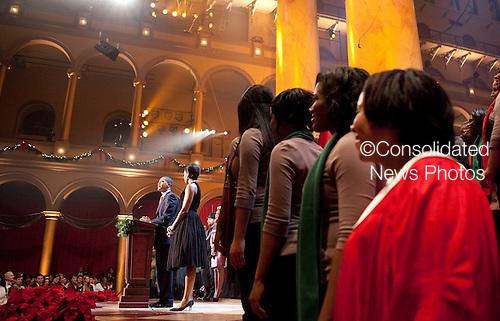 Washington, DC - December 13, 2009 -- United States President Barack Obama and First Lady Michelle Obama speak at the conclusion of the Christmas in Washington celebration in Washington, D.C., U.S., Sunday, December 13, 2009. .Credit: Joshua Roberts / Pool via CNP