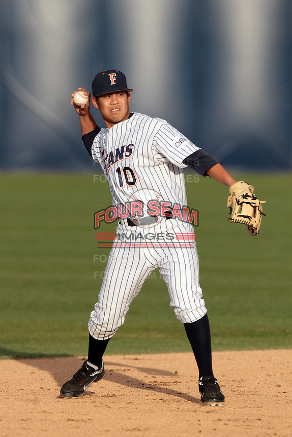 Anthony Trajano #10 of the Cal State Fullerton Titans makes a throw against the Loyola Marymount Lions at Goodwin Field on February 29, 2012 in Fullerton,California. Cal State Fullerton defeated LMU 6-2.(Larry Goren/Four Seam Images)
