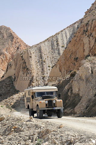 Africa, Tunisia, nr. Saket. Land Rover Ambulance ascending from the famous narrow gorge near Saket.  --- No releases available, but releases may not be needed for certain uses. Automotive trademarks are the property of the trademark holder, authorization may be needed for some uses.