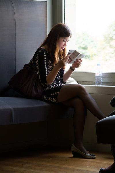 Woman reading tour guide.  Louvre Museum, Paris.
