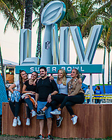 MIAMI, FL - FEBRUARY 2: Fans pose for pictures at the beach as they arrive to watch  the Super Bowl XLIV Live at the beach on February 2, 2020 in Miami, USA. (Photo by Kena Betancur/VIEWpress/Getty Images)