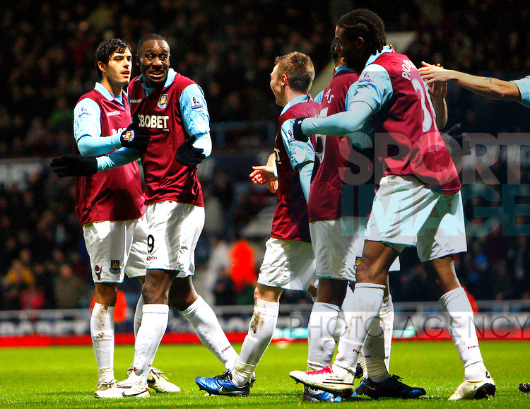 Carlton Cole of West Ham United celebrates Ronald Zubar of Wolverhampton Wanderers's own goal