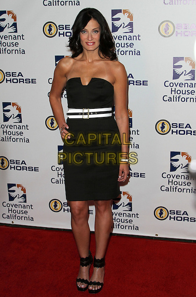 Dayanara Torres.Covenant House California 2011 Gala and Awards Dinner Held At The Skirball Cultural Center, Los Angeles, California, USA..June 9th, 2011.full length black strapless dress hand on hip white belt stripe ankle strap sandals shoes .CAP/ADM/KB.©Kevan Brooks/AdMedia/Capital Pictures.