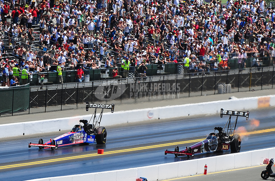 Jul. 17, 2010; Sonoma, CA, USA; NHRA top fuel dragster driver Antron Brown (left) races alongside Larry Dixon during qualifying for the Fram Autolite Nationals at Infineon Raceway. Mandatory Credit: Mark J. Rebilas-