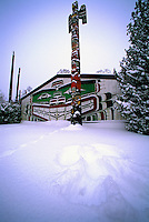 Snow Angel in Snow at Kwakwaka'wakw (Kwakiutl) Longhouse and Totem Pole in Thunderbird Park, Victoria, Vancouver Island, BC, British Columbia, Canada - Winter