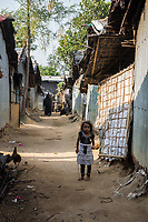 Bangladesh, Cox's Bazar. Kutupalong Rohingya Refugee Camp. The Rohingya, a Muslim ethnic group  denied citizenship in Burma/Myanmar have escaped persecution from Burmese militants in their country. There are up to 500,000 migrants and refugees living in makeshift camps in Cox's Bazar. Little girl.