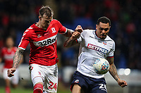 Bolton Wanderers' Josh Magennis competing with Middlesbrough's Aden Flint <br /> <br /> Photographer Andrew Kearns/CameraSport<br /> <br /> The EFL Sky Bet Championship - Bolton Wanderers v Middlesbrough -Tuesday 9th April 2019 - University of Bolton Stadium - Bolton<br /> <br /> World Copyright © 2019 CameraSport. All rights reserved. 43 Linden Ave. Countesthorpe. Leicester. England. LE8 5PG - Tel: +44 (0) 116 277 4147 - admin@camerasport.com - www.camerasport.com