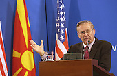 United States Secretary of Defense Donald H. Rumsfeld answers a reporter's question during a press conference in Skopje, Macedonia, on October 11, 2004.  Rumsfeld went to Skopje to attend a bi-lateral meeting with Macedonia officials.  <br /> Mandatory Credit: James M. Bowman / DoD via CNP