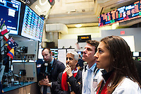 U.S. Women's National Team midfielder Carli Lloyd (R to L), former U.S. Men's National Team star Jeff Agoos, and U.S. Soccer President Sunil Gulati watch the ticker from the floor of the NYSE during the centennial celebration of U. S. Soccer at the New York Stock Exchange in New York, NY, on April 02, 2013.