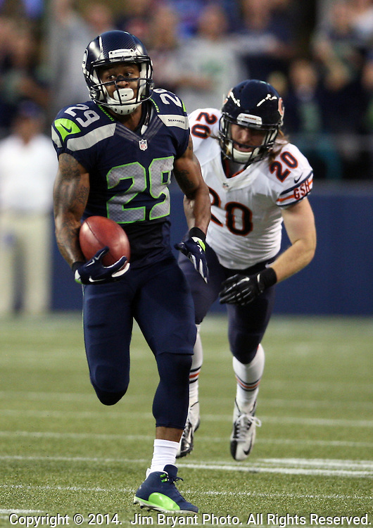 Seattle Seahawks punt return specialist Earl Thomas  (29)  returns a punt 59-yards against the the Chicago Bears in a pre-season game at CenturyLink Field in Seattle, Washington on August 12, 2014.  Seattle beat Chicago 34-6. ©  Jim Bryant Photo. ALL RIGHTS RESERVED.