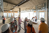 Alumni and staff tour the construction of the Career Development Center's and National Awards and Pre-Law and Pre-Health Advising's offices as part of Hard Hat View: Inside the new Hameetman Career Center on Friday, June 12, 2015 as part of Alumni Reunion.<br /> (Photo by Marc Campos, Occidental College Photographer)
