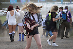 © Joel Goodman - 07973 332324 . 06/06/2015. Manchester , UK.  Festival goers walk backwards in to strong gusts of wind stirring up dust and grit . Early arrivals at The Parklife 2015 music festival in Heaton Park , Manchester . Photo credit : Joel Goodman