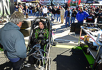 Oct. 26, 2012; Las Vegas, NV, USA: NHRA funny car driver Alexis DeJoria is fitted in her car by Dennis Taylor during qualifying for the Big O Tires Nationals at The Strip in Las Vegas. Mandatory Credit: Mark J. Rebilas-