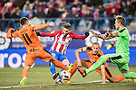 Yannick Ferreira Carrasco (c) of Atletico de Madrid competes for the ball with Ruben Pena Jimenez (l) and Alejandro Galvez Jimena of SD Eibar as goalkeeper Yoel Rodriguez Oterino of SD Eibar tries to save the shot during their Copa del Rey 2016-17 Quarter-final match between Atletico de Madrid and SD Eibar at the Vicente Calderón Stadium on 19 January 2017 in Madrid, Spain. Photo by Diego Gonzalez Souto / Power Sport Images