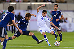 Azizbek Turgunboev of Uzbekistan (R) is tackled by Sasaki Sho of Japan (L) during the AFC Asian Cup UAE 2019 Group F match between Japan (JPN) and Uzbekistan (UZB) at Khalifa Bin Zayed Stadium on 17 January 2019 in Al Ain, United Arab Emirates. Photo by Marcio Rodrigo Machado / Power Sport Images